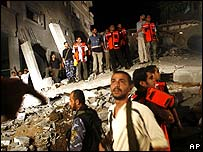 Palestinians inspect destroyed house