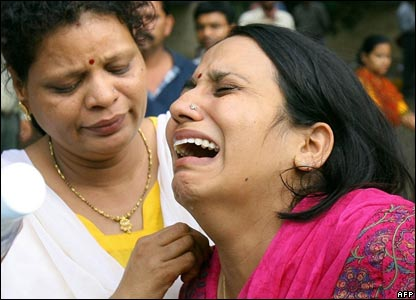 A woman breaks down after hearing her husband died (12/07)
