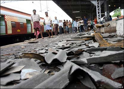 Commuters survey wreckage at Mahim station