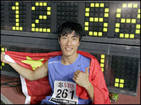 Liu Xiang celebrates his new 110m hurdles world record