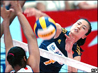 China's Zhou Suhong smashes the ball during a match with Cuba in Beijing