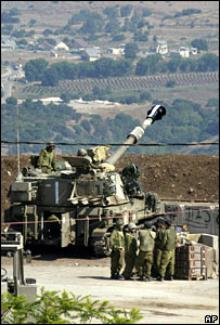 An Israel artillery piece prepares to fire into Lebanon from a position on the border near Moshav Margaliyot