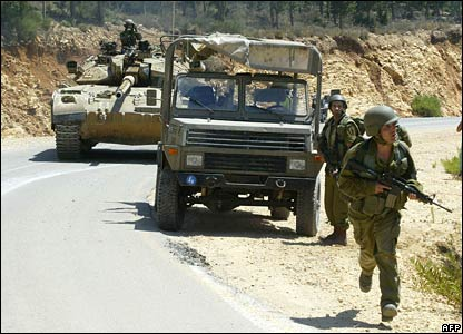 Israeli troops and military vehicles