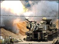 An Israeli mobile artillery unit fires shells across the border into southern lebanon
