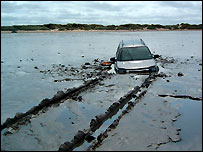 Land Rover stuck in mud at Berrow Beach, Somerset