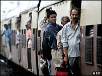 Commuters travel to work the after Mumbai train blasts