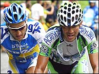 Juan Miguel Mercado (right) out-sprints Cedric Dessel (left) to win stage 10