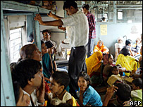 Train commuters travel in Mumbai