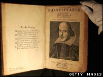 A Sotheby's employee with a copy of William Shakespeare, The First Folio 1623