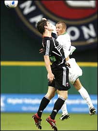Bobby Boswell of DC United challenges for the ball with Celtic's Kenny Miller
