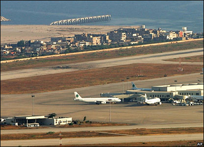 A crater is seen on the runway of the Rafik Hariri International Airport in Beirut after Israeli air strikes