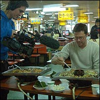 Producer Alex Mackintosh films Stefan who has been served dog meat in a restaurant