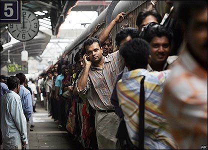 Commuters on a train in Mumbai, India