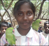 15-year-old Tamil refugee Bhovana Nishanthini Lombert with her parrots