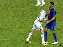 Zinedine Zidane headbutts Marco Materazzi in the chest during the World Cup final
