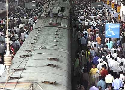 Commuters at Victoria Terminus station in Mumbai