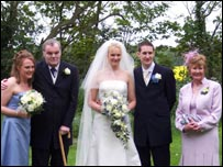 Left to right daughter and bridesmaid Susie Lyles, Ronnie Lyles, daughter and bride Katie Higgins, groom Matt Higgins and Ronnie's wife and mother of bride Sally Lyles