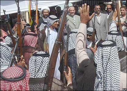 Supporters salute Iraqi President Nouri al-Maliki