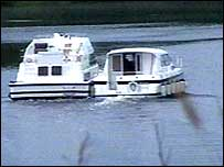 The boat pictured on the left was towed away