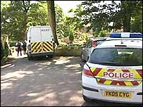 Police at entrance to How Royds Hall, Barkisland