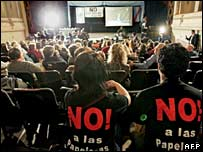 Opponents gather in an Argentine theatre to hear the ruling