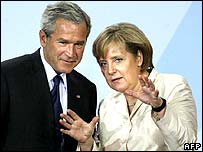 George Bush and Angela Merkel