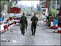 Lebanese troops walk through rubble in southern port of Saida