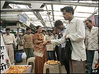 Commuters at a station in Mumbai