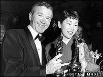 Red Buttons and Japanese actress Miyoshi Umeki with their Oscars for Best Supporting Actor and Actress, March 1958