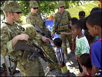 Australian peacekeepers chat to children at a Dili refugee camp on 9 July