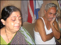 The mother and father of Mumbai bomb victim Manish Dhavekar