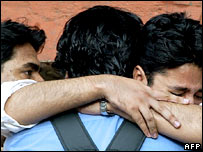 A grieving relative of a Mumbai bomb victim is consoled