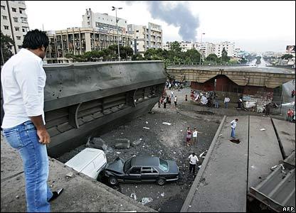 Gaping hole in a road bridge left by Israeli raids