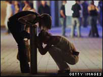 Drunk person in street scene