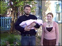 Sergei Rozov with his wife and baby daughter