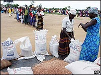 Internally displaced people line up to receive food aid at the Pabbo camp outside Gulu, northern Uganda