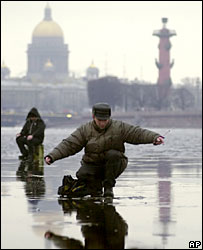 Fishermen on the frozen ice of the Neva River in St Petersburg, Russia (Dec 2004)
