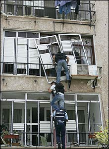 Israeli police search an apartment block in Nahariyya