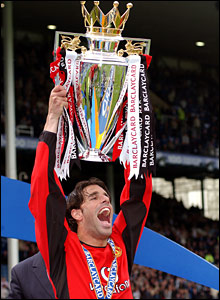 Ruud holds the Premiership trophy aloft