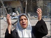 Lebanese woman reacts after an Israeli air strike in the suburbs of Beirut
