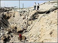 Lebanese civilians inspect bomb damage
