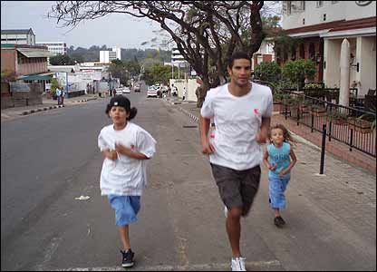David James runs the mile with his two sons in Malawi