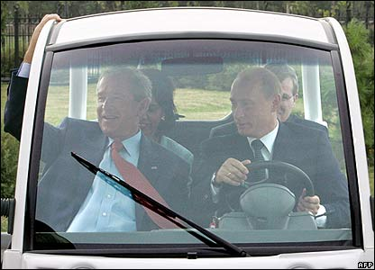 George W Bush (left) with Vladimir Putin in golf cart in St Petersburg