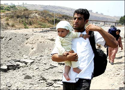 Man carrying baby near crater