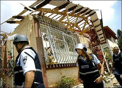 Police inspect damaged house