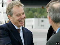 Tony Blair is greeted as he arrives at St Petersburg airport