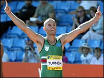 Andy Turner celebrates his hurdles win