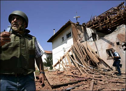 Security forces in Israel inspect house hit by a barrage of rockets