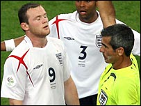 Referee Horacio Elizendo shows Rooney the red card in Gelsenkirchen