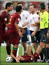 Rooney argues with Ronaldo (far left) and Petit as Carvalho lies injured on the turf